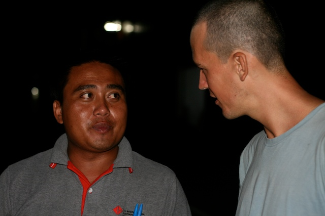 Chris with the local guy who taught us Lao